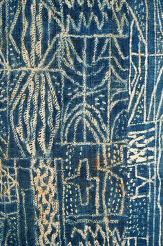 """Ndop"" which is a raffia, stitched-resist, indigo dyed, textile done primarily in Cameroon but also in other West African countries."