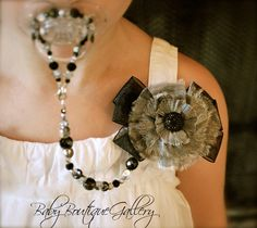 Baby Boutique Black Flower 4-in-1 Beaded Pacifier Holder. $27.99, via Etsy.