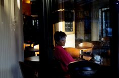 Sans autorisation (Calinore) Tags: street city light woman paris france asian restaurant cafe solitude femme soir rue ville ruederivoli asiatique eveing bistrot attente restauration