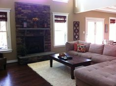 Family Room with Gas Fireplace and Stone Surround in Kelsea Model