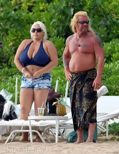 The hottest couple in all of bail bonding took to the beaches of Hawaii as Dog The Bounty Hunter stars Duane Chapman and wife Beth Chapman released their hot bods on their own recognizance at the Fairmont Kea Lani on the island of Mauii Sunday.    Dog had his most wanted frame wrapped in a towel while Beth looked to be the star of The Brashank Redemption as she kept her famous pair of troublemakers locked up tight in a blue bikini top. Ol Dog's gettin' quite the pot belly there! He better be car