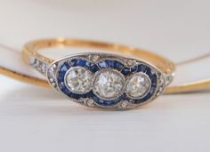 SOLD, DECEMBER PAYMENT Fabulous Art Deco Vintage Engagement Ring. 3 Old European Diamonds with Baguette Sapphire Halo. by SweetHeirloomVintage on Etsy https://www.etsy.com/listing/252756486/sold-december-payment-fabulous-art-deco