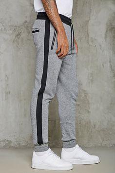 A pair of heathered fleece knit sweatpants featuring an elasticized drawstring waist, zippered slant pockets, a back welt pocket, ribbed cuffs, and contrast trim. Mens Jogger Pants, Mens Sweatpants, Joggers Womens, Adidas Tracksuit Mens, Nike Socks Women, Grey Sports Leggings, Boys Kurta Design, Joggers Outfit, Fleece Pants