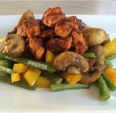 Fried chickenbreast in red pepper powder and a little bit of tomatosauce with stir fried veggies!