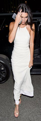 Kendall Jenner wears a white Calvin Klein Collection dress with strappy sandals