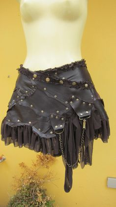 BURNING MAN..patch choc leather mini skirt with stud detail,D ring and chain..... $85.00, via Etsy.