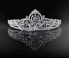 Known as the 'Belgian Scroll tiara', this beautiful piece was made by Henry Cossmans for Princess Josephine-Charlotte, daughter of Leopold III and Astrid of Sweden, when she wed Jean, Gradn Duke of Luxembourg, on 9 April 1953.