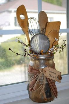 Mason Jar grundged and old utensils w/homespun material and paper tag. Great way to display mom or grsndma's old kitchen things