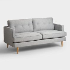 A Clean Silhouette, Tufted Detailing And Tapered Danish Inspired Legs Give  Our Sofa A