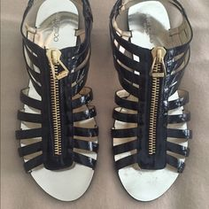 Jimmy Choo Black Patent Zip Cage Flat Sandal Jimmy Choo Zip Cage Flat Sandal in black patent, in Women's size 40 (US 10). Very little wear on the top of the shoes. Does have wear on the soles as seen in photo. Excellent used condition and perfect for summer! Comes with the original dustbag. Jimmy Choo Shoes Sandals