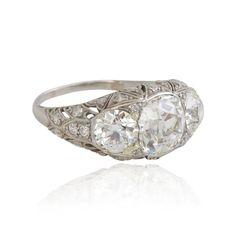 Amazing large Edwardian three stone platinum diamond ring. Over 5 carats of sweet diamonds!