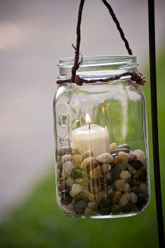 Mason jar hanging candle holders. Use sand instead of pebbles. Some jars can be coated with glass paint to match colored bottles. 12 quart size jars are about 11.00. Suggest different sizes. Small jelly jars are quilted creating a faceted glow from candle.