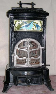 """""""Le Parisien"""" no 12  Superb Art Nouveau tile decorated  multi-fuel stove, from antiquefrenchstove.com"""