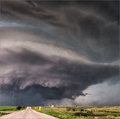 Massive #supercell #thunderstorm looming over the prairie near Lipscomb, #Texas. June 22, 2014.