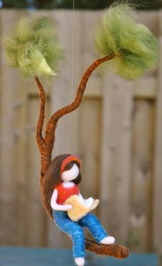 Girls Room Decor needle felted : Girl reading a book in a branch This is a Waldorf inspired piece made of wool by the needle-felting technique. Its been created to provide a peaceful and harmonious image that Needle Felted Ornaments, Felt Ornaments, Wet Felting, Needle Felting, Felt Fairy, Girl Reading, Reading Room, Felting Tutorials, Fairy Dolls