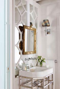 Wall sconces and white marble basin on chrome base by Lorenzo Castillo; Antique French mirror.    - Veranda.com