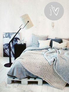 blue and grey bed. crocheted blankets... made out of angora would = the perfect bed.