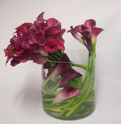 3 WAYS WITH CALLA LILIES. Florists at Flowers by Teresa created a gorgeous display using only Calla Lilies. By keeping the stems long, they were able to use them as a sculptural feature to add extra interest and texture. Flowers by Teresa; (02) 9559 3369, www.flowersbyteresa.com