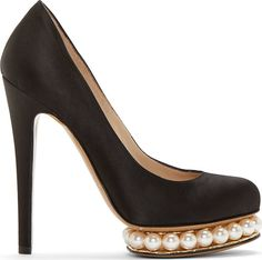 "Stiletto pumps in black satin. Large pearls embedded in a sculpted gold-tone platform. Lining and sole in tan leather. Tonal stitching. Approx. 5"" heel."