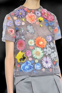 Christopher Kane- Made of 70 percent aluminum organza with 100 percent plastic floral stickers