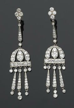 A pair of art deco diamond and platinum earrings each pendant earring set throughout with European and transitional-cut diamonds; with original box; estimated total diamond weight: 3.00 carats.