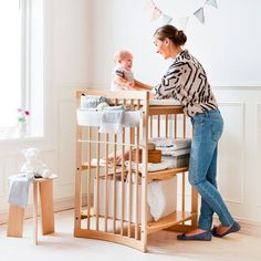 Stokke® Care™ has been designed so that your baby can lie facing you rather than sideways. This allows you to face your baby for play and interaction while making diaper changes far easier. Cool Baby Gadgets, Baby Equipment, Baby Zimmer, Nursery Room Decor, Everything Baby, Baby Essentials, Baby Hacks, Crib Bedding, Cool Baby Stuff