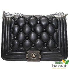 Accessorize your look with leather touch soft quilted Ladies Hand Bag exclusively available at India Bazaar online shop. Accessories are the heart-throb for girls and when it comes to selection of bags, they cross limit to choose the best one. With this essential fact in mind, we have come up with this elegant black bag with snap closure to hold all your daily essentials.