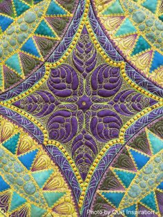 close up, Pickle Promenade by Betty Santa.  2014 AZQG.  Machine embroidery design by Sharon Schamber.  Photo by Quilt Inspiration