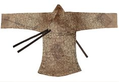 Late 17th century unlined, gauze Dang-ui (ceremonial jacket) Excavated from the tomb of Yoon (ca.1610-1701) in Paju, Gyeongi-do. Yoon was the wife of Lee Hyeong-bo, the fifth rank government official. The fabric has a lotus pattern, the sleeves have wide cuffs in a white tabby, with a squared collar. The outer breast ties are made of dark brown tabby silk, and the inner ties are smaller and lighter in color. From the Dankook University Seok Juseon Memorial Museum.