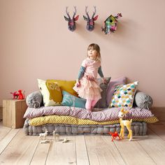 brilliant. create a couch out of bench cushion and pillow mats. add two bolsters and some large pillows and you have an easy to put together and take apart piece that is comfortable and versatile. love the deer and owl pillow and things...