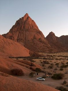 The Spitzkoppe is a group of bald granite peaks or inselbergs located between Usakos and Swakopmund in the Namib desert of Namibia. Africa Travel, Us Travel, Safari, Namib Desert, Namibia, West Africa, Wonders Of The World, Monument Valley, Places To Go