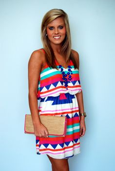 We know you will love this bright dress! Monogram the clutch!