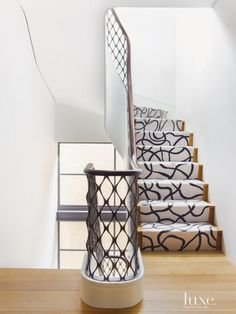 The new staircase was fabricated by NE&WS Metal Works with the railing forged by Julius Blum & Co.; the mahogany cap was finished by Anglo Inscape. The pattern in the custom Tai Ping carpet runner does not repeat once in its six-floor run.