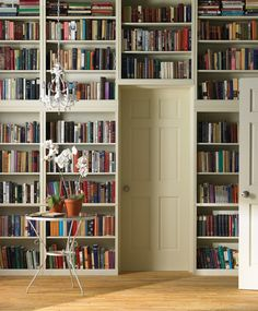 Full wall librarie at door side.