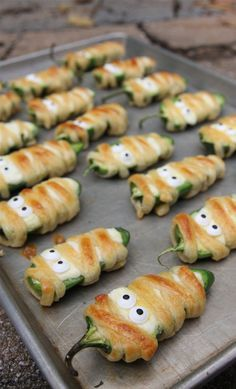 Halloweeño Jalapeño Popper Mummies are so festive! Great for a party! #halloween #recipes homechanneltv.com
