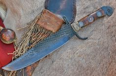 Bowie from Heller hoof rasp. circa 1850s, coins inlet into the handle with pitch glue. Deer rawhide sheath is wrapped with braintan deerskin. Awesome 12 inch blade with tapered tang. Mountain man, buckskinner, rendezvous, trapper, bowie, file knife, custom knife