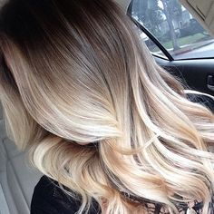 Ombre blonde wavy hair. Dark to platinum
