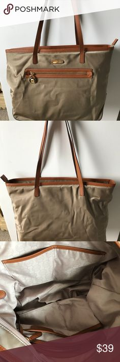 b960b118faa312 Michael Kors Nylon Tote Large Nylon Shoulder Tote with leather trim and  fabric lining. Dual