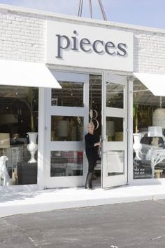 white brick store front / lee kleinhetler of pieces - for colour of building Home Decor Store, At Home Store, Home Stores, Brick Store, Exterior Signage, Atlanta Homes, Store Displays, Retail Displays, Merchandising Displays