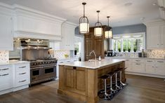A balance of white and natural wood add warmth to this Connecticut kitchen.