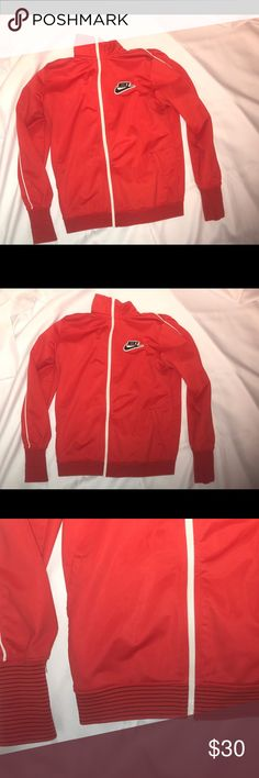 Nike track Jacket women's Nike track jacket for the ladies fitted jacket. Amazing red jacket has a lot of swagg to it no stains in excellent condition smells like a million dollar deal. Make me a great offer Nike Jackets & Coats