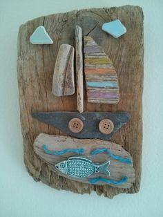 Driftwood art with boat theme. By Philippa Komercharo.