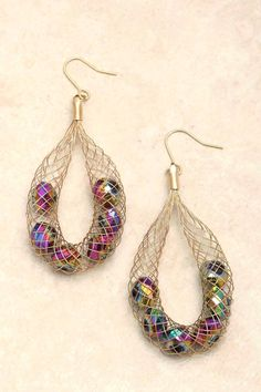 "Need to DIY these!    Golden wire weave cradles shimmery Facted Cut Crystals. Earrings Size: 3""L x 1""W (photo only)"