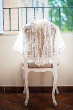 #Capelet for church ceremony | See the wedding on SMP: http://www.StyleMePretty.com/destination-weddings/2014/01/27/rome-destination-wedding/ Rochelle Cheever Photography