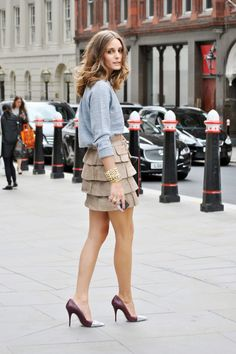 We love the high-low pairing in Olivia Palermo's sweatshirt and tiered skirt outfit.Photographed by Melanie Galea