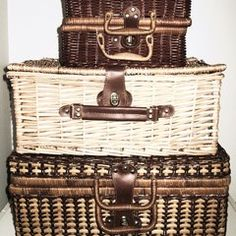 Vintage picnic baskets as storage--Gustav and Gayle blog