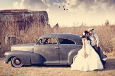 Vintage couple with car