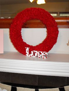 I love Styrofoam wreath forms. No gluing required. This is covered with fuzzy red fabric and pinned with satin pins. The love sign I found at Michael's craft for $1. I just added some red dots and BAM prettiness @ One Orange Giraffe