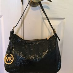 MICHAEL by Michael Kors shoulder bag Black patent leather adjustable shoulder bag. Like new. Kept in dust bag. 11wx7hx3d roomy interior with one zip pocket  can go day to evening  trades Michael Kors Bags Shoulder Bags