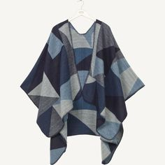 A super soft brushed cape with a cosy blanket-style feel. Wrap it around your shoulders to keep warm and toasty in any weather.